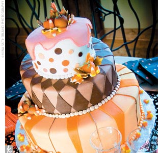 Wanting something different, Jessica decided to go for a Mad Hatter-style cake. The bottom layer was a pound cake with amaretto cream filling (Ryan's favorite), and the top and middle layers were strawberry with strawberry icing (Jessica's favorite). The funky cake had a different design on each tier. The cake was adorned with fall-inspired gum pas ...