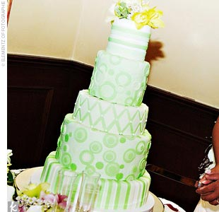 Arlene and Dennis cut a five-tiered cake covered in green striped and spotted patterns made with rolled fondant. The top tier was devil's food cake with mocha buttercream filling, and the others were vanilla cake filled with lemon and orange buttercream.