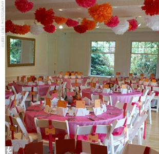 Another of Clise Mansion's many assets was that it had plenty of space to contain the couple's 143 guests. They were spread out among three rooms, seated at a mix of circular and rectangular tables with hot pink table covers.