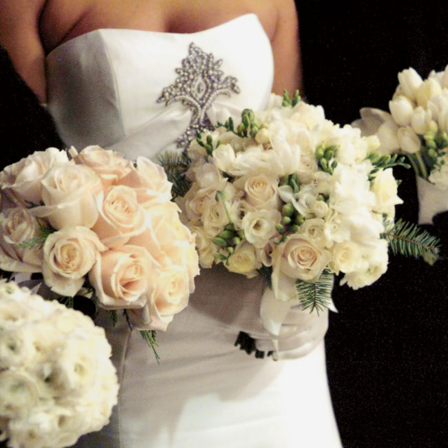 Each maid carried a bouquet of all one type of ivory-color flower -- roses, ranunculus, or tulips -- and the bride carried a mix of all three.