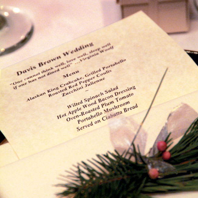 A sprig of berries and evergreens adorned the menus set at each seat.