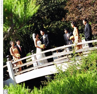 "Caroline and Jonathan wed on a bridge over a koi pond, with their guests sitting around them on either side. ""It was very intimate, even with 200 guests,"" the bride says. Instead of having a traditional tea ceremony at home, the couple chose to incorporate a brief tea ceremony into their Western ceremony. Their officiant explained its significance  ..."