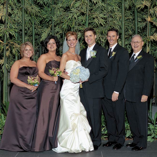 Alicia's two bridesmaids wore chocolate brown, floor-length ensembles by Amsale and carried fresh bouquets of orchids and greenery.