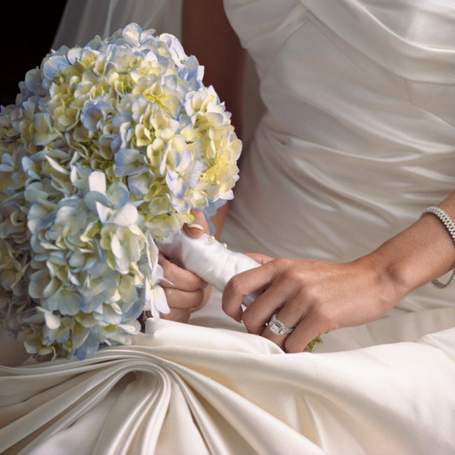 The bride carried a bouquet of blue hydrangeas.