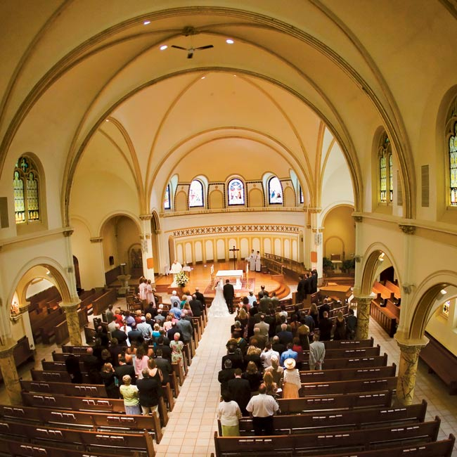 "The traditional Catholic ceremony was held at St. Thomas the Apostle Catholic Church. ""It reminded us of the churches we saw in Rome,"" Andrea says. The classically beautiful space was decorated only with fabric-wrapped topiary trees near the entrance. After the mass, Mike and Andrea arranged to meet their parents and Andrea's grandmother outside in ..."