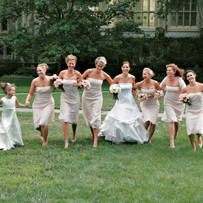 Andrea's six bridesmaids wore blush-color georgette, tea-length gowns by Dessy Collection. For the church ceremony, each woman covered her shoulders with a matching sheer wrap.