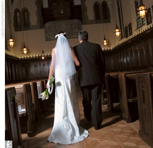 Tina walked down the aisle of Grosse Pointe Academy Chapel with her father on one arm and her grandfather on the other. Her gown echoed the wedding's ribbon theme in strips of elegant pearl taffeta.