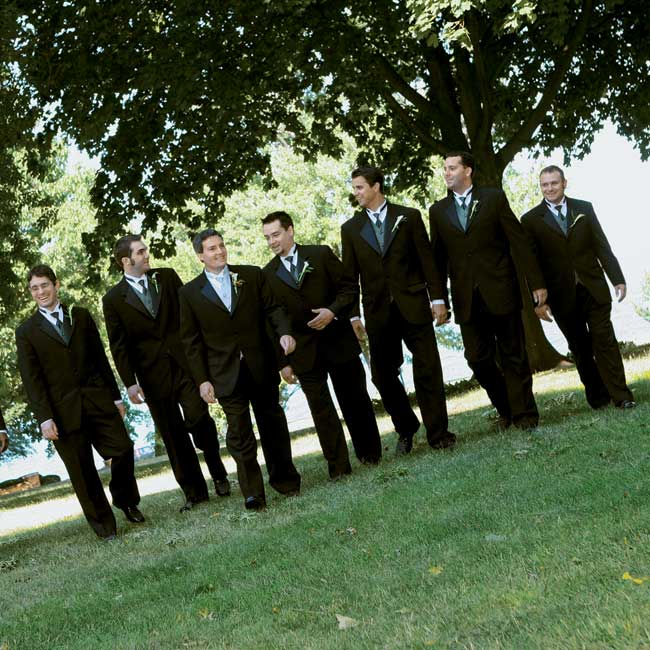 Jason, his groomsmen, and Tina's bridesman wore tuxedos with different-color vests: platinum for the groom, green for the groomsmen, and tan for Tina's attendant.