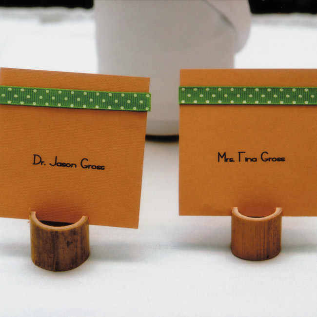 Guests were greeted with a refreshing mojito, the couple's signature drink, and located their seats with the help of ribbon-adorned place cards, which stood in holders made from bamboo shoots hand-cut by Jason and his father.