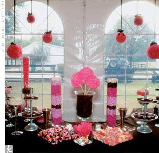 "Balls of pink carnations hanging from chocolate brown ribbons attracted all eyes to the reception's focal point, an enormous candy buffet made up of pink and brown treats, which Amy and Justin had opted for instead of wedding cakes. ""The candy bar is what everyone was talking about in the weeks following the wedding,"" Amy says."