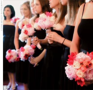 The bridesmaid bouquets of peonies, tulips, roses, and sweet pea popped against their dark dresses.