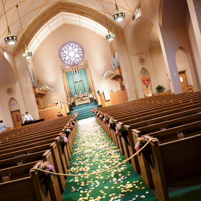 """Ashley and Ben exchanged vows in the Kessler Park United Methodist Church, which was spacious enough to hold their 350 guests but still felt quaint and intimate. The father of the bride wrote the couple's vows, incorporating scripture verses from the books of Ruth and Ephesians. """"Our vows really emphasized how sacred the covenant of marriage is and ..."""