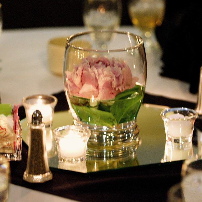 The reception was held at the Infomart. White linens and black napkins topped the tables, which were also set with centerpieces of a single pink peony in a low vase and votive candles atop an octagonal mirror.