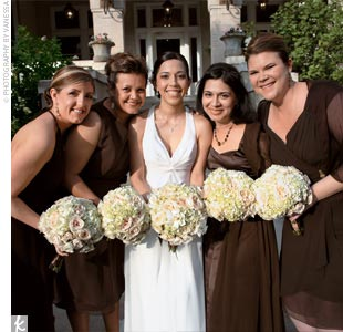 "Jenn decided on a slender V-neck chiffon gown with beading on the neckline by Maggie Sottero. Her four bridesmaids live all across the country and are all different sizes, so she decided to let them pick their own dress styles in chocolate brown chiffon. ""I wanted my friends to have fun and feel comfortable on the wedding day,"" the bride says."