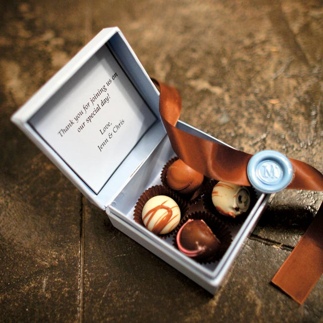 Jenn and Chris filled light blue boxes with truffles and tied them with brown ribbon. Inside the lid of each box was a card thanking guests for sharing in the wedding day.