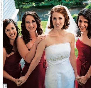 Angela's five bridesmaids (including her best friend, three younger sisters, and sister-in-law) wore claret-color satin dresses with a chiffon overlay that featured a narrow sash at the waist.