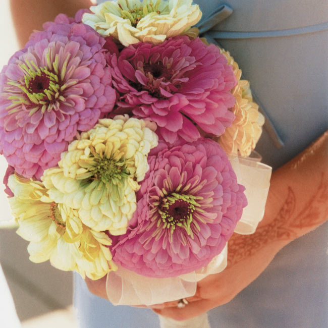 Sai carried a bouquet of orchids and lilies, and the women in the bridal party carried bouquets in shades of pink and cream.