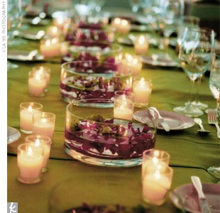 Every table was scattered with small votives, while the head table was covered in lime green moire and floating flowers.
