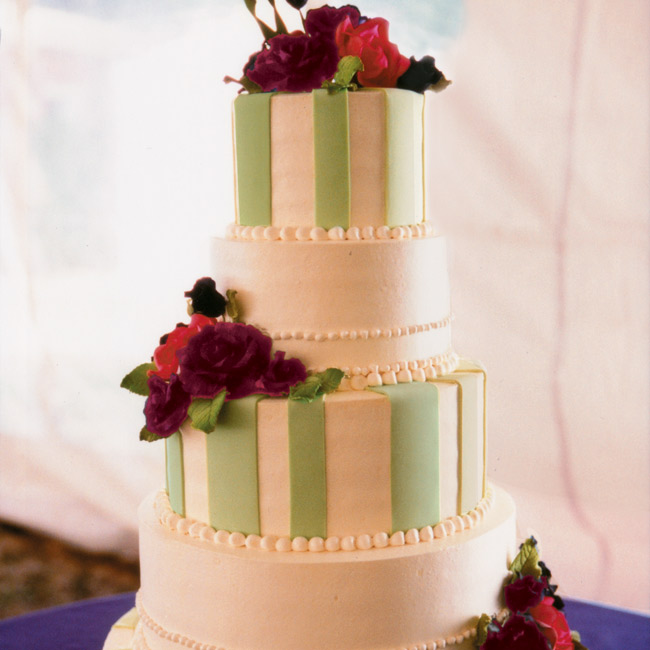 "What Sterling calls her ""favorite cake of all time"" was a five-tiered vanilla cake with raspberry and cream fillings, iced in ivory buttercream frosting and topped with green fondant stripes and dark purple and raspberry edible flowers."