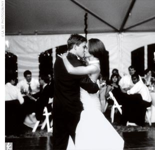 "Once dinner was finished, guests danced to a 7-piece big band beneath the tent. The newlyweds had their first dance to Frank Sinatra's ""Fly Me to the Moon,"" which was David's idea as a way to honor their unique engagement site. ""We were over-the-moon happy,"" Sterling says. ""So not only was it a great song to dance to, but the lyrics fit in a fun, u ..."