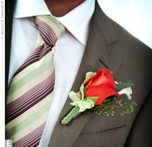 Joel's Canali suit complemented Thara's dress perfectly, and the boutonniere matched the theme of the wedding.