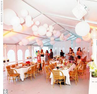In order to give the reception a dinner party ambience, the couple chose long tables instead of small circular ones. The Chinese hanging lanterns and flower décor added an elegant touch, while a guitarist played classic rock ballads.
