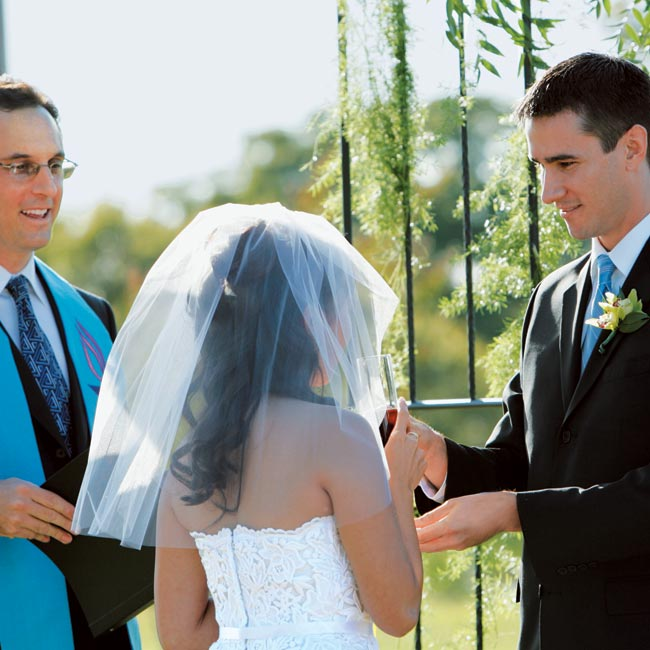Both the ceremony and reception took place at Winfrey Point, a city-owned building that sits beside White Rock Lake. With the large main room, screened-in porches, and lakeside outdoor patio, it was perfect for Melissa and Dave (and not just because they live right nearby!). The couple exchanged vows on a grassy lawn rimmed by the building's drive. ...