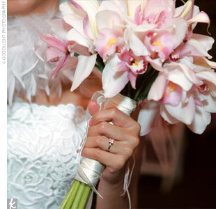 Orchids (Melissas favorite flower) in white, pink, and green made up the bouquets.