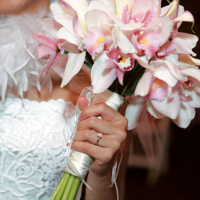 Orchids (Melissa's favorite flower) in white, pink, and green made up the bouquets.