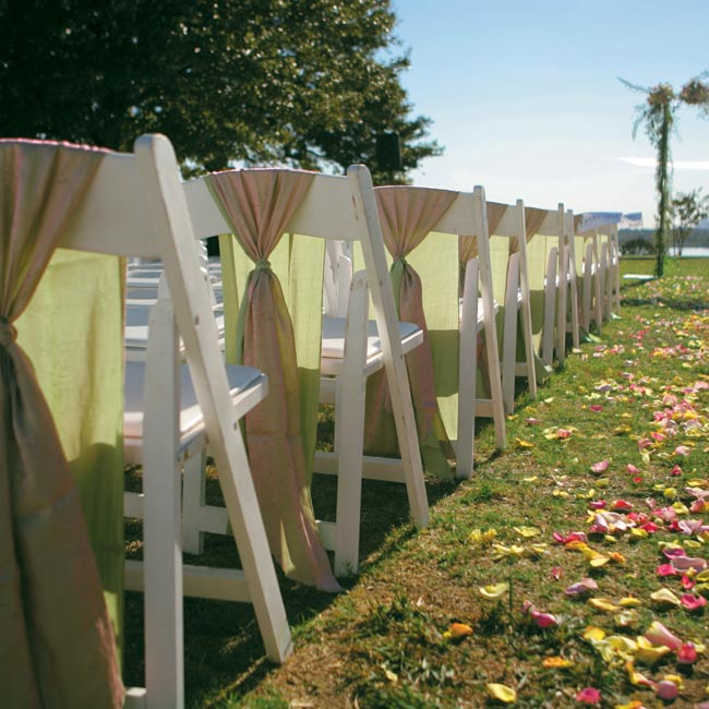 The ceremony featured a subtle color scheme of pink and green, bringing in just a touch of the riotous color to come. Pink and green flowers decorated the arbor and the aisle.