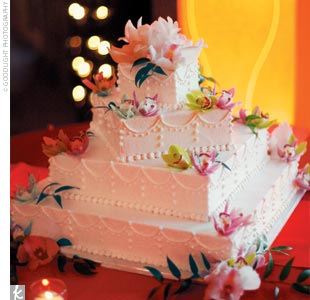 These wedding&#39;s signature hues were later picked up in the wedding cake -- a four-tier square confection decorated with pink and green cymbidium orchids.