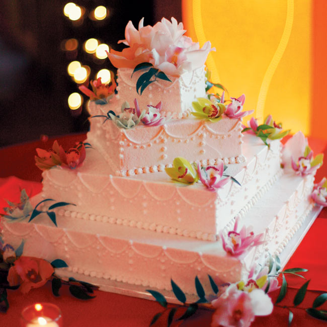 These wedding's signature hues were later picked up in the wedding cake -- a four-tier square confection decorated with pink and green cymbidium orchids.