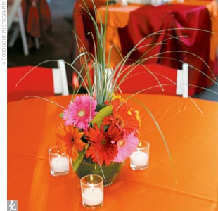 Centerpieces were made up of multicolored gerbera daisies (another of the brides favorite blooms), though in this case it wasnt just about the look: We requested the centerpieces be a height that would allow guests to see around them when they talked to each other, Melissa says.