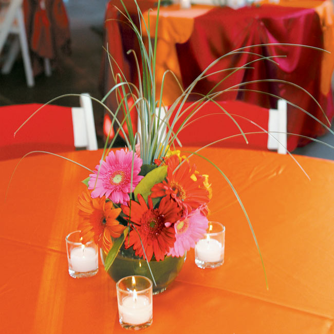 "Centerpieces were made up of multicolored gerbera daisies (another of the bride's favorite blooms), though in this case it wasn't just about the look: ""We requested the centerpieces be a height that would allow guests to see around them when they talked to each other,"" Melissa says."