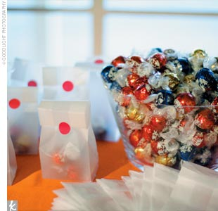 Guests could pick up chocolate truffles from a favor table and pack them up in bags -- sealed with bright red stickers -- to take home.