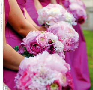 "The bride's lifelong favorite color—pink—provided the inspiration for the wedding's eye-popping style. ""We accented the different shades of pink with candy apple green, which was perfect for a spring wedding,"" Meredith explains. The nine bridesmaids wore strapless, raspberry taffeta, floor-length dresses by Amsale. And, of course, the flowers were  ..."