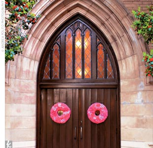 Wreaths of pink flowers adorned the doors to the Highland Park United Methodist Church, where Meredith and Kyle said, I do.