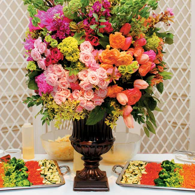 At the entrance and on the buffet tables, tall arrangements of pink peonies, pink and green hydrangea, pink and champagne ranunculus, tulips, and other blooms held sway.