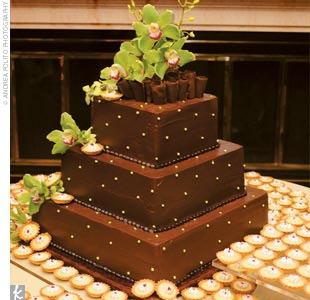 Kyles grooms cake was the perfect complement: a three-tier square, chocolate fudge cake frosted in chocolate ganachecoated buttercream. A cascade of green cymbidium orchids provided a burst of color, as did the key lime pie tartlets (the grooms favorite dessert) that covered the cake table.