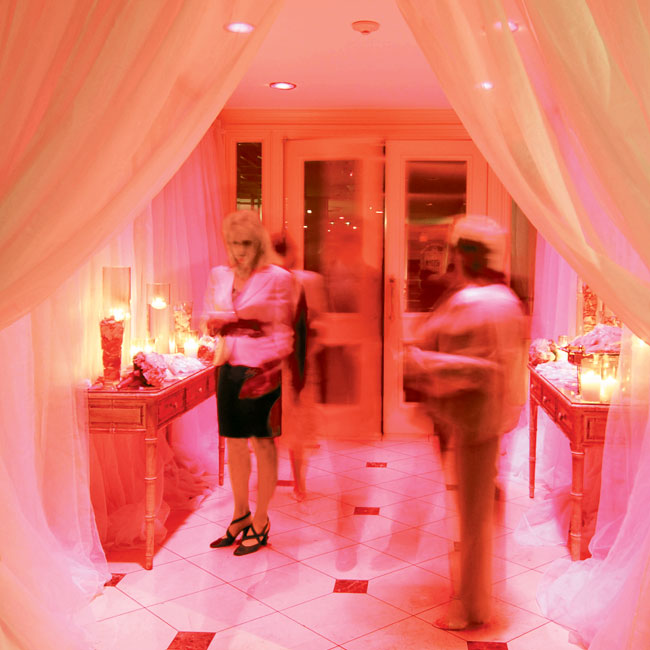 The entrance to the ballroom was draped in pink fabric, as was the wall behind the band, and more soft pink lighting made the room glow.