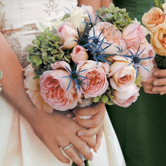 Peach-colored roses with a hint of purple thistle, which grows wild in the South, made up the majority of the bouquets. Rosemary was also used in remembrance of loved ones who could not be with the couple on their special day.