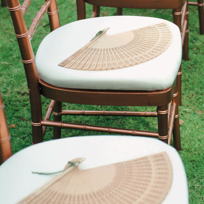 Balsa wood fans kept guests cool and served as functional favors.