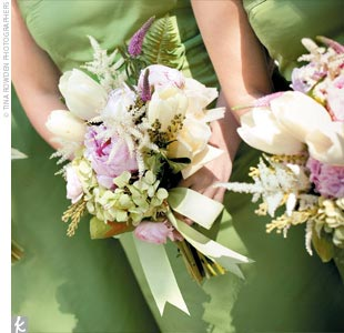 The bridesmaids carried garden-inspired bouquets of pink peonies, white French tulips, pink veronica, chartreuse green hydrangeas, pink ranunculuses, and white astilbe.