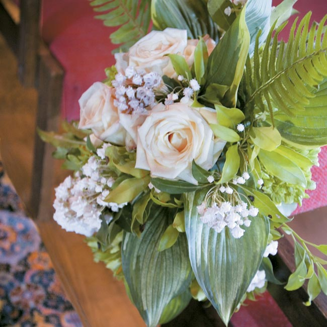 The prettiest display of blossoms appeared on the buffet, where large, lush arrangements of white peonies, white hydrangeas, viburnum, woodland ferns, white French tulips, and pale pink roses made an impressive statement.