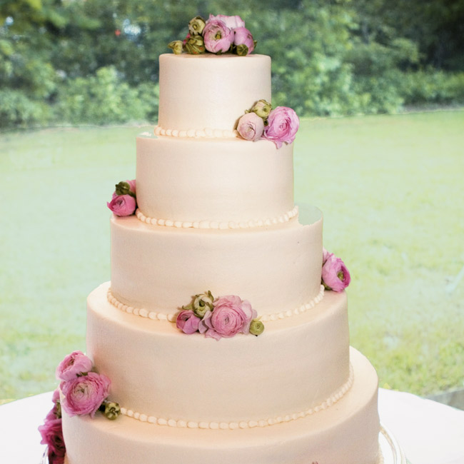 Laura and Trey's cake exuded springtime style with five buttercream-frosted tiers punctuated with pink ranunculuses.