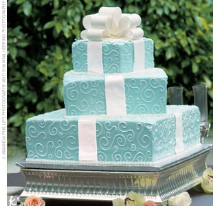 Tying the Tiffany blue color palate together was the wedding cake: a three-tier confection with strawberry filling and cream-cheese frosting made to resemble three stacked Tiffany & Co. boxes wrapped with a large white fondant ribbon that cascaded down the side of the cake.