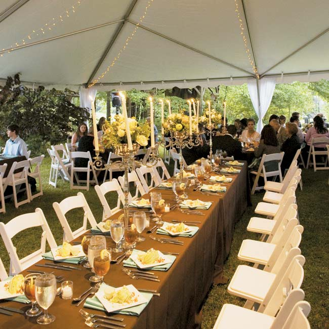 After the ceremony, guests made their way to a nearby tent that was illuminated with two crystal chandeliers and plenty of candles. A mix of square and round tables were draped with chocolate brown tablecloths and Tiffany blue napkins.