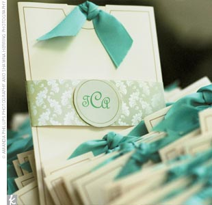The programs offered the first hint of the wedding's signature colors of Tiffany blue and white: White booklets were placed in crisp white envelopes wrapped with a Tiffany blue ribbon and stamped with the couple's monogram, also in Tiffany blue.