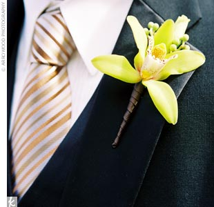The guys all wore Kenneth Cole black tuxedos, but Kenny traded the gold and brown striped BCBG tie worn by the groomsmen for a gold one by Thomas Pink. A lime green cymbidium orchid boutonniere tied the look together.