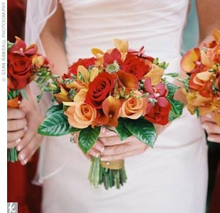The bright red and orange flower arrangements were created with calla lilies, orchids, and roses featured prominently in tight, modern designs. Lisa's bouquet was put together in such a way that she could pull out four roses—as she walked down the aisle, she handed a rose to her mother and grandmother, and (after she and Will were officially marrie ...